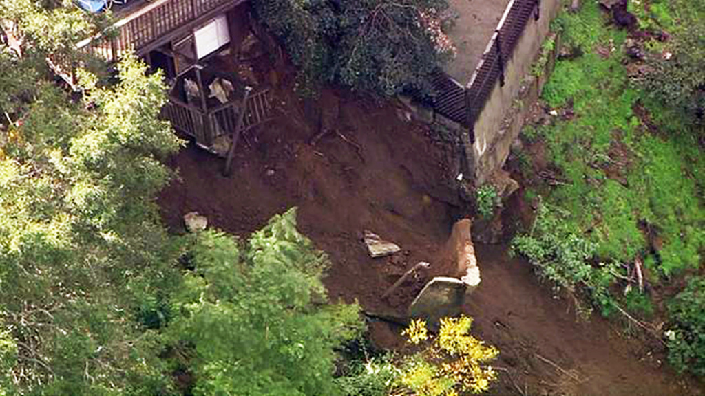 This image made from video provided by KABC-TV shows a slab of concrete that broke away from a home and slid down a rain-soaked hillside in Los Angeles' Hollywood Hills neighborhood Wednesday, Jan. 11, 2016. Some mud and debris fell as far as Laurel Canyon Boulevard below the home, causing the road to be closed. (KABC-TV via AP)