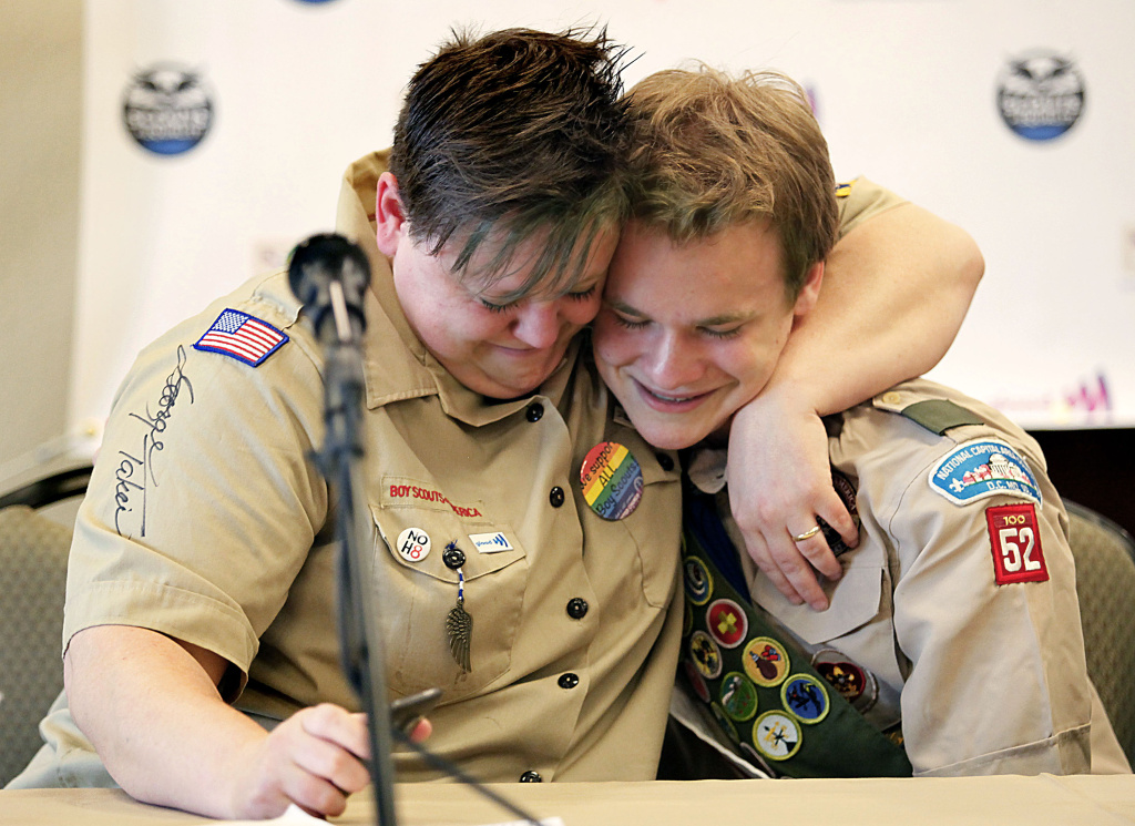 Jennifer Tyrrell of Bridgeport, Ohio, hugs Pascal Tessier, 16, of Kensington, Maryland, at a news conference held at the Great Wolf Lodge May 23, 2013 in Grapevine, Texas. The Boy Scouts of America ended its policy of prohibitting openly gay youths from participating in Scout activities, while leaving intact its ban on gay adults and leaders.