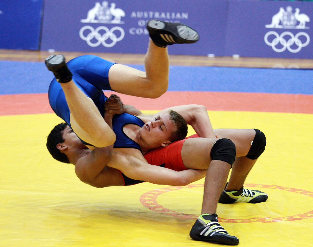 Guilherme Dias of Brazil (red) competes against Sean Odea of Australia during the Freestyle 85 kg Wrestling event in the Sports Halls at Sydney Olympic Park Sports Centre on January 20, 2013 in Sydney, Australia.  (