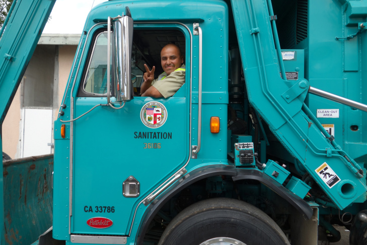 Luis Santana drives a Los Angeles Bureau of Sanitation garbage truck April 23, 2015.