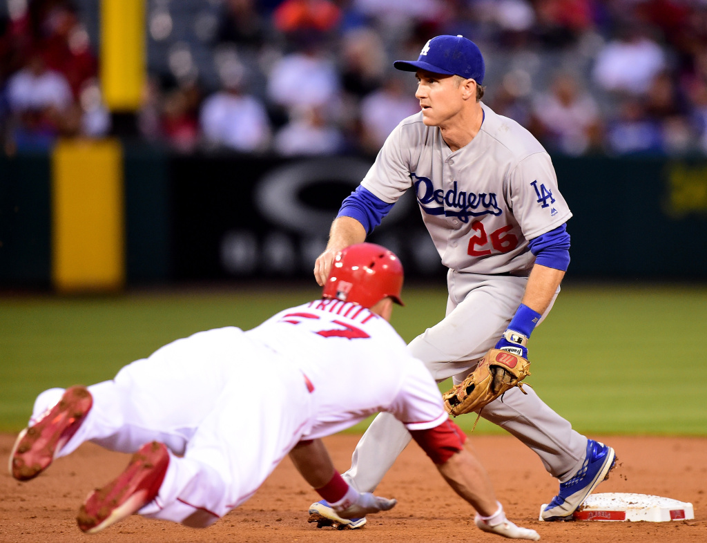 ANAHEIM, CA - MAY 19:  Mike Trout #27 of the Los Angeles Angels steals second base as Chase Utley #26 of the Los Angeles Dodgers waits for the throw during the first inning at Angel Stadium of Anaheim on May 19, 2016 in Anaheim, California.  (Photo by Harry How/Getty Images)