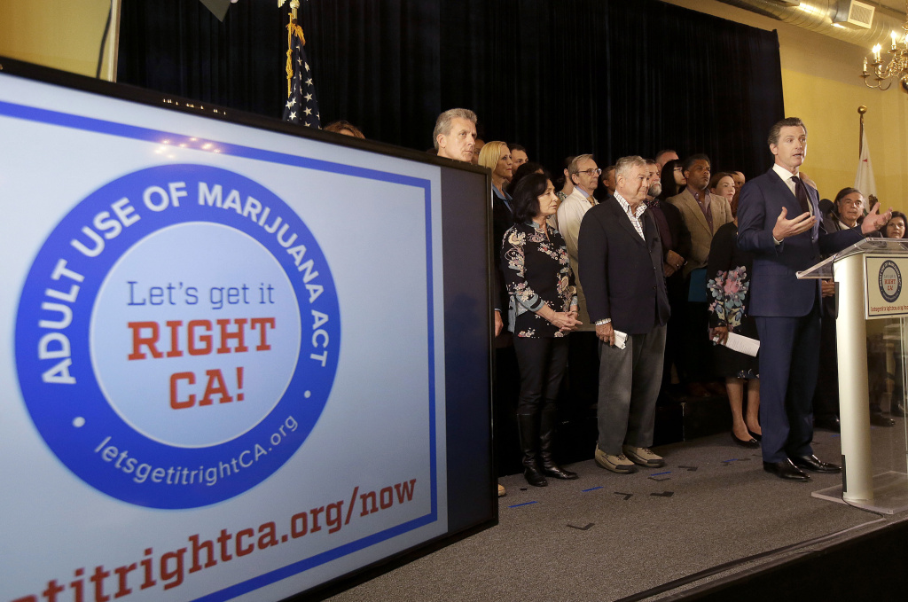 Lt. Gov. Gavin Newsom, right, speaks in support of the Adult Use of Marijuana Act ballot measure in San Francisco, Wednesday, May 4, 2016. Backers of a marijuana legalization initiative said Wednesday they have collected enough signatures for the measure to qualify for the November ballot in California. (AP Photo/Jeff Chiu)