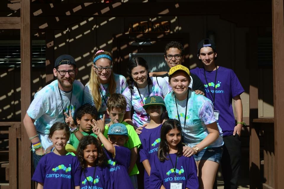 Claire Witzke (in the yellow cap) as a counselor at Camp Kesem USC 2014.