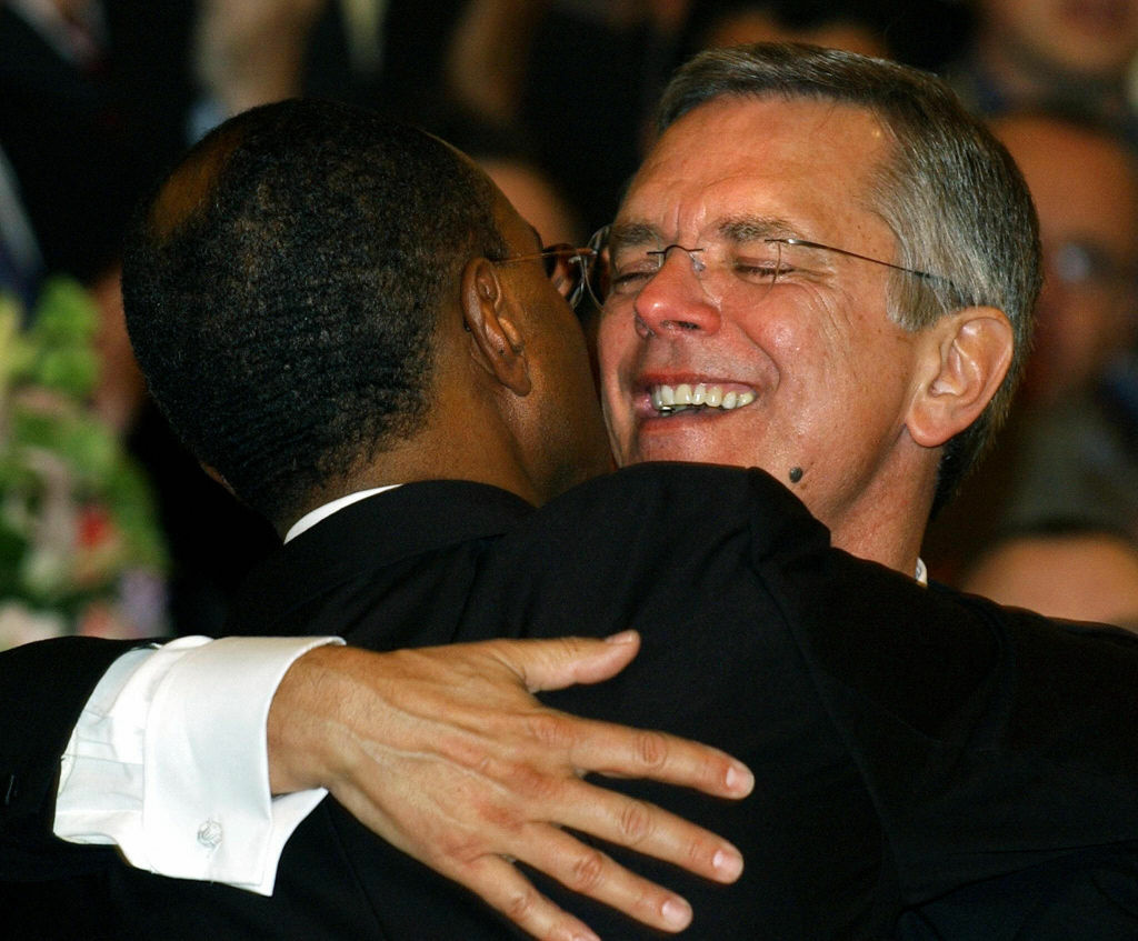 David Wilson (left) and Rob Compton embrace after being married by a Unitarian minister at the Arlington Street Church in Boston on May 17, 2004. They were one of the first couples in Massachusetts to be legally wed.