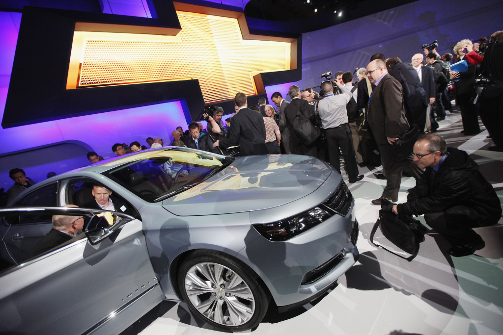 Media members and enthusiasts inspect the newly unveiled 2014 Chevrolet Impala at the New York International Auto Show at the Jacob Javits Convention Center on April 4, 2012 in New York City. The New York International Auto Show features nearly 1,000 brand new vehicles from all auto industry sectors and is open to the public April 6-15.