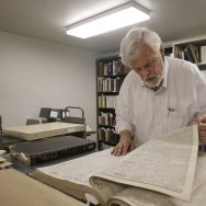 Bob Hirst, general editor of the Mark Twain Project, looks through a book of 1866 Sacramento Union newspapers at The Bancroft Library at the University of California Berkeley in Berkeley, Calif., Monday, May 4, 2015. Scholars at the University of California, Berkeley have pieced together a collection of dispatches written by MarkTwain when the author was a young newsman in San Francisco. (AP Photo/Jeff Chiu)