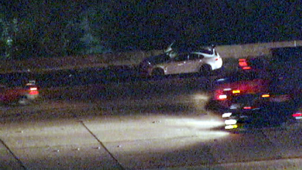 A stolen Jaguar on the side of the 405 Freeway early Monday.