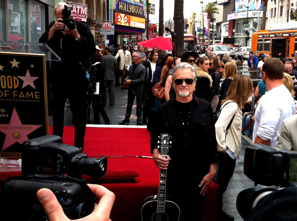 Kris Kristofferson poses at the Hollywood Walk of Fame ceremony for Janis Joplin.