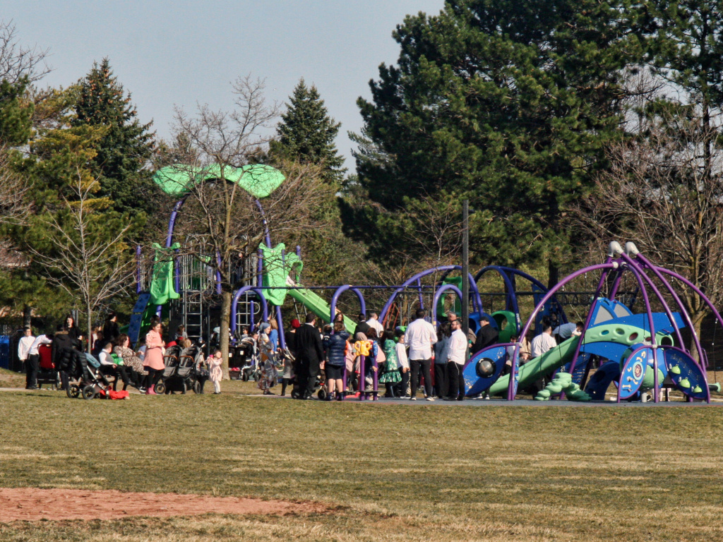 A crowd of parents and children at a playground during the COVID-19 pandemic in Toronto, Ontario, Canada on April 4. The country is experiencing a third wave of the coronavirus pandemic.