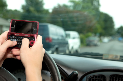 A driver texting while driving.