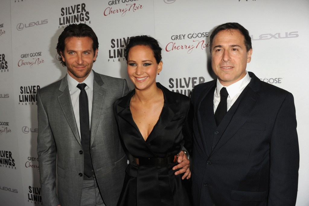 (L-R) Actor Bradley Cooper, actress Jennifer Lawrence and director David O. Russell attend a screening of The Weinstein Company's