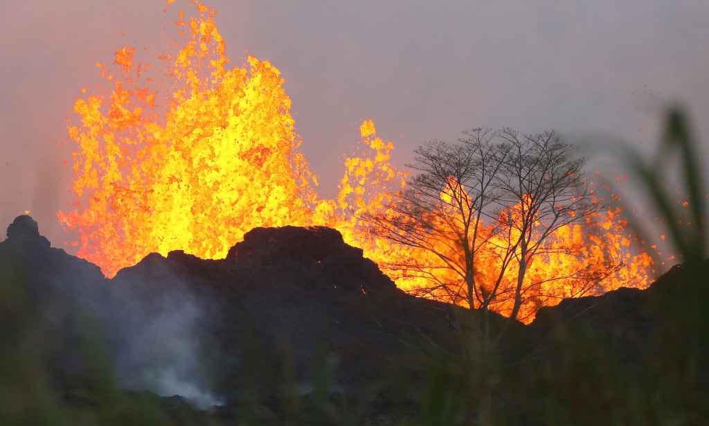 Lava from a Kilauea volcano fissure erupts on Hawaii's Big Island on May 20, 2018 in Kapoho, Hawaii. The volcano erupted explosively on May 17, launching a plume of smoke and ash about 30,000 feet into the sky.