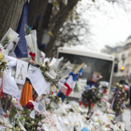 Singer of the rock group Eagles of Death Metal, Jesse Hughes, pays tribute to the victims of the 2015 Paris terrorist attacks at a makeshift memorial in front of the Bataclan concert hall in Paris.