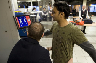 A passenger undergoes a security scan at Schiphol airport on December 28, 2009