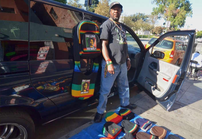 Kenneth Simpson sets up on Alvarado Street in MacArthur Park, and sells Bob Marley flags, t-shirts and accessories.