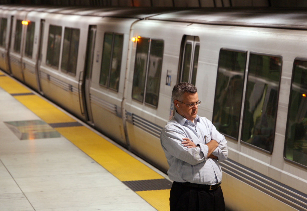 SAy Area Rapid Transit (BART) customer waits for a train at the Embarcadero station August 14, 2009 in San Francisco, California.