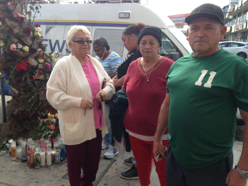 Let to right: Rosemary Orellana, Luis Alonso Orellana and Isidora Orellana near a makeshift memorial on Monday, Oct. 24, 2016 for the tour bush crash that left 13 dead. They all knew the driver and had been casino trip customers. Isidora was close to one of the victims, but does not know how to locate her family now.