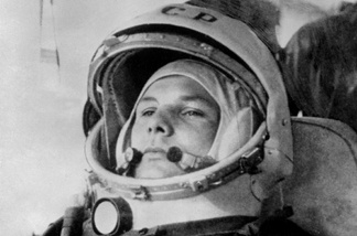 Yuri Gagarin, 27, (1934-68) wearing cosmonaut helmet, prepares to board Soviet Vostok I spaceship 12 April 1961 at Baikonur rockets launch pad shortly before its take-off to became the first man to travel in space, completing a round-the-Earth circuit.