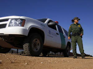 A U.S. Border Patrol agent patrols along the U.S.-Mexico border in Naco, Ariz., in September.