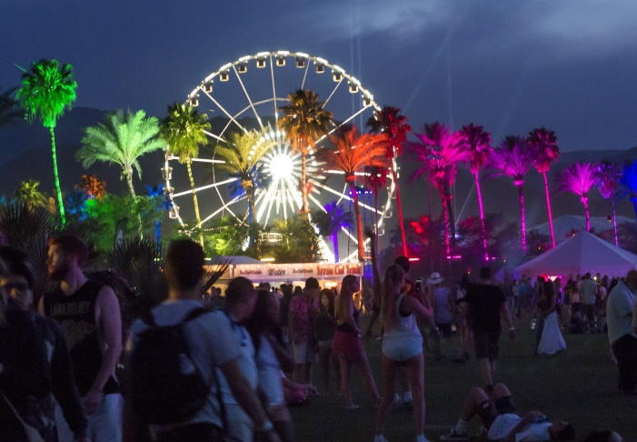 Colored lights illuminate palm trees on the first day of the Coachella Music Festival, in Indio, California, April 10, 2015.  AFP PHOTO / ROBYN BECK        (Photo credit should read ROBYN BECK/AFP/Getty Images)