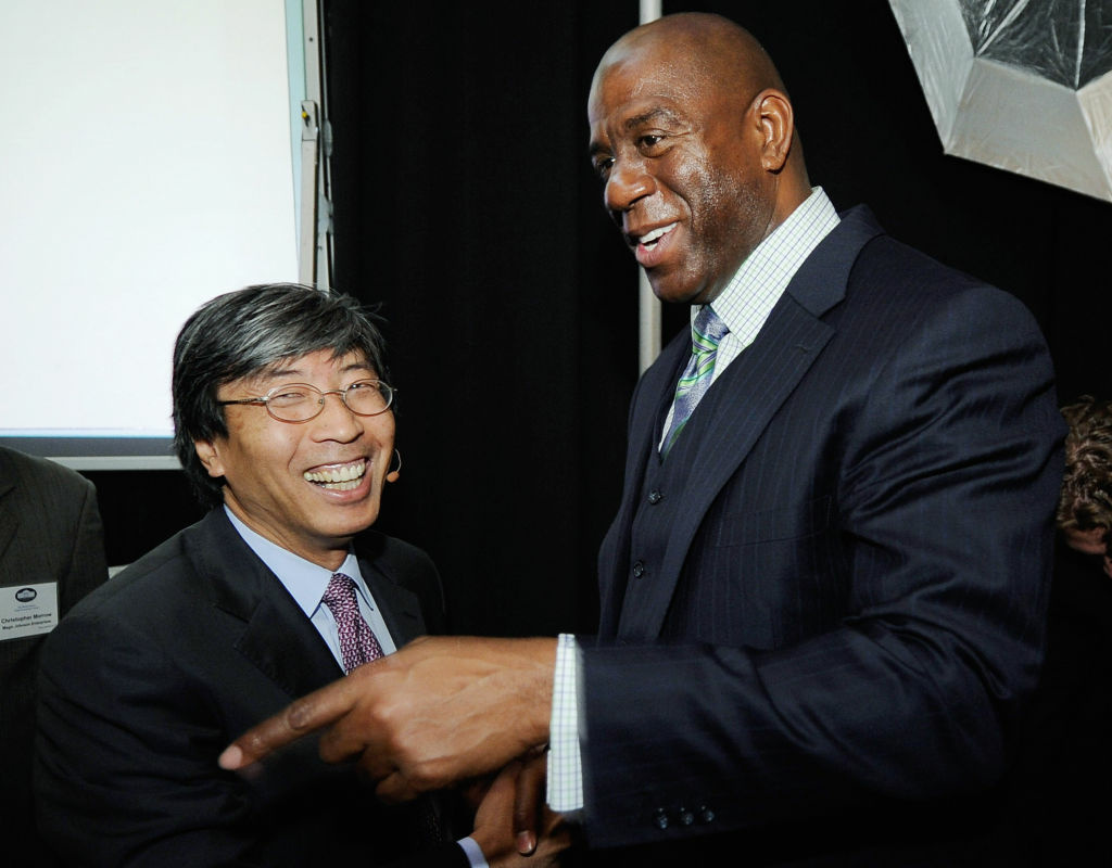 Magic Johnson greets Patrick Soon-Shiong during a Urban Economic Forum co-hosted by White House Business Council and U.S. Small Business Administration. They could be partners (sort of) if Soon-Shiong and Guggenheim Partners buy AEG.