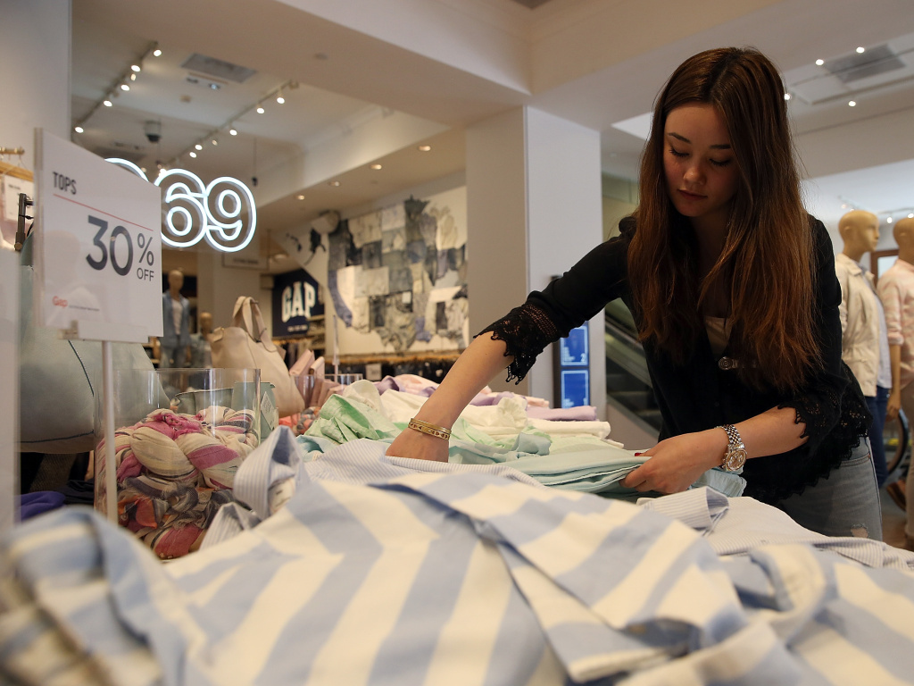 A Gap employee works at a store in San Francisco in this undated photo.