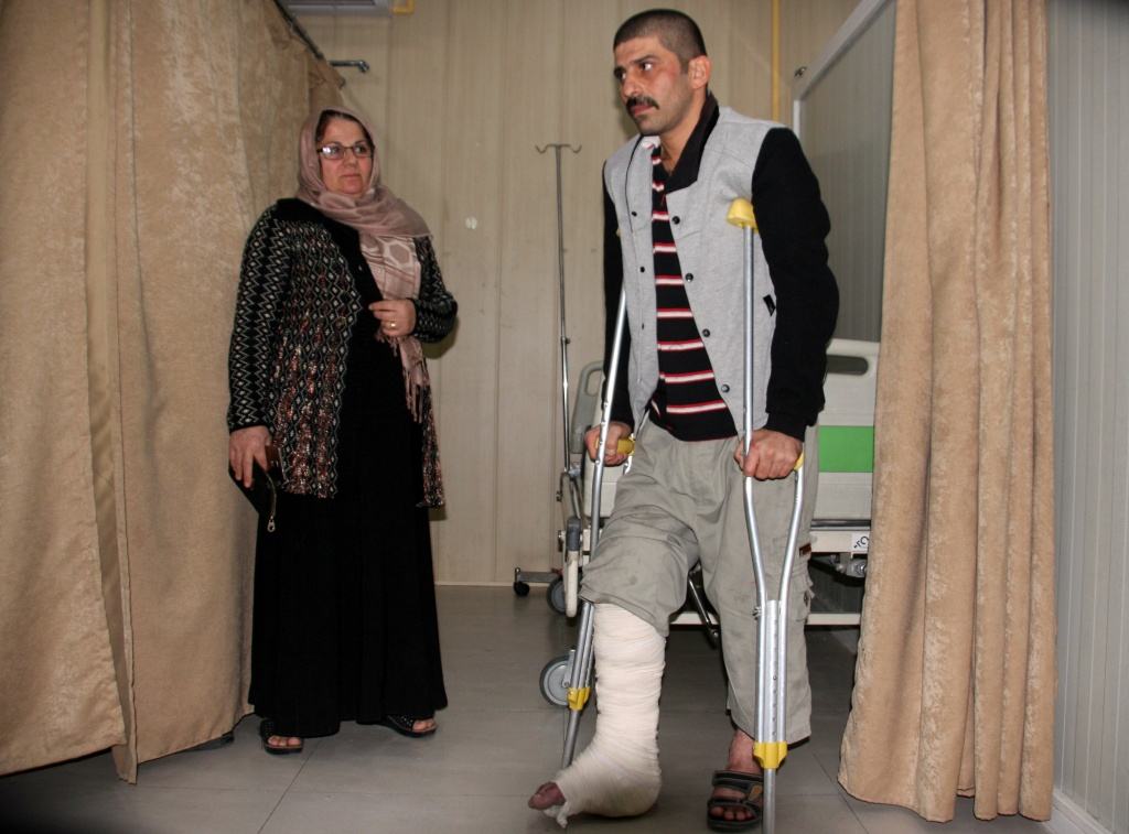 A man receives aid at Sulaimaniyah Hospital in Iraq on November 12, 2017, after a 7.3 earthquake hit the region.