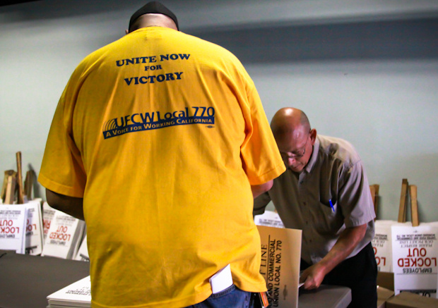 Grocery workers assemble picket signs at the Local 770 headquarters in Los Angeles ahead of a possible strike.