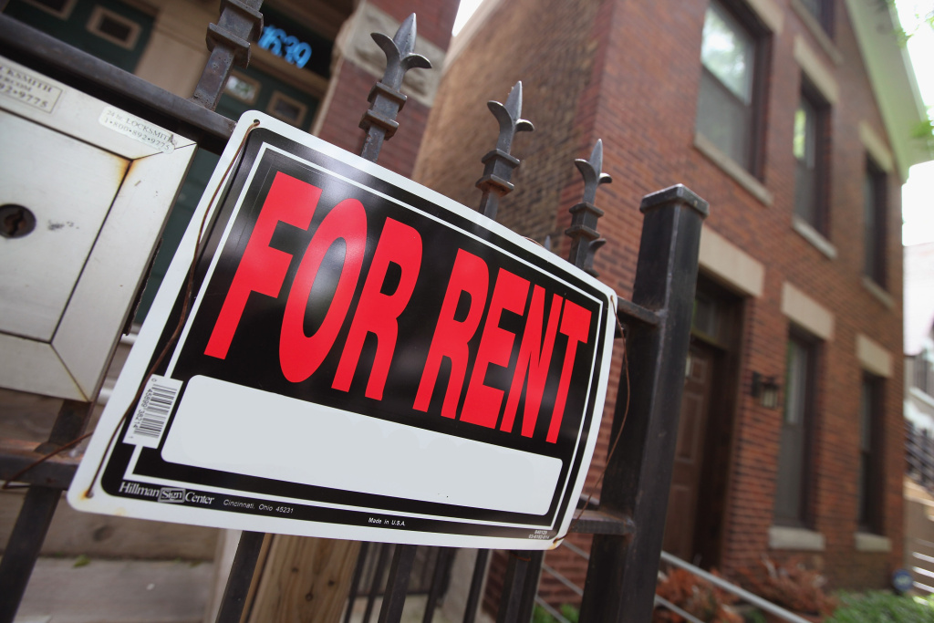 A 'For Rent' sign stands in front of a house on May 31, 2011 in Chicago, Illinois.