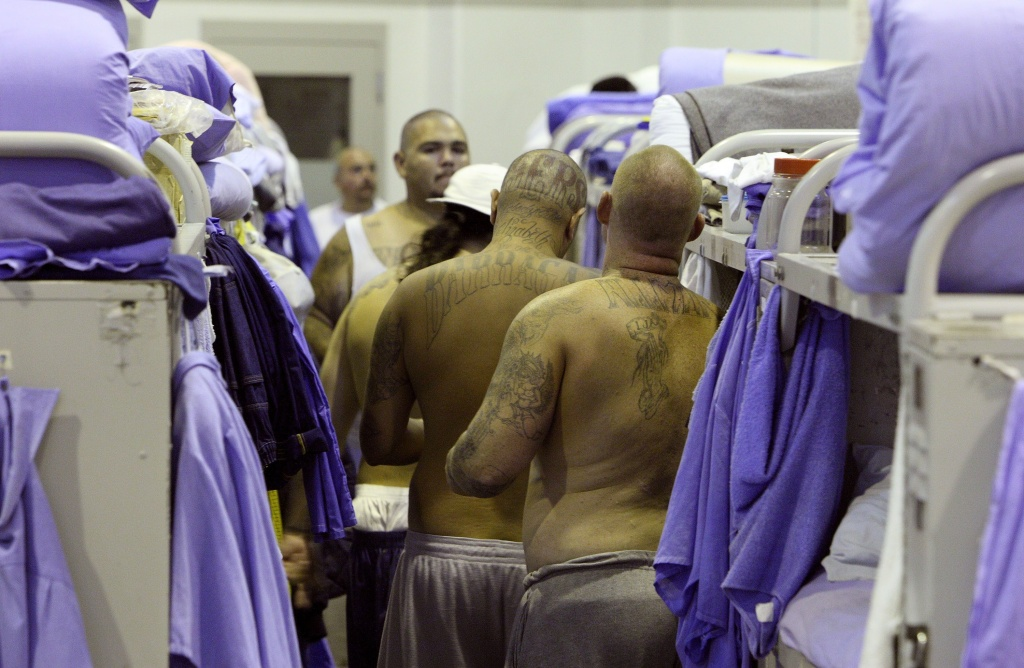 Inmates at the Mule Creek State Prison crowd between bunk beds in a gymnasium that was modified to house prisoners August 28, 2007 in Ione, California.
