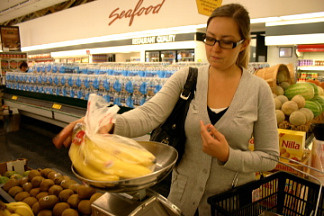 Reporter Katie Evarts shops for groceries for the food stamp challenge. Evarts' challenge was to spend only $36.50 on her food for one week.