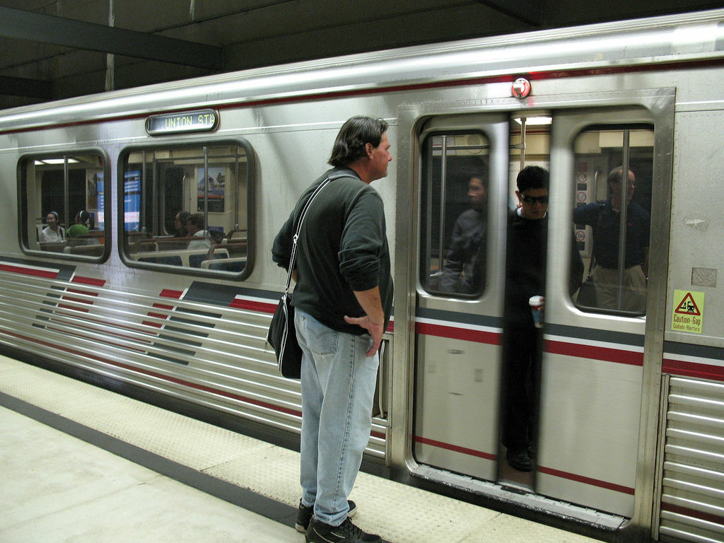 File photo: A man waits at the Civic Center Metro Station for a train going to Union Station. Railroads will be outfitted with a new brake system by the middle of next year.
