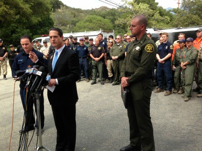 Orange County Supervisor Todd Spitzer speaks in front of rescuers who found two Orange County teen hikers alive.