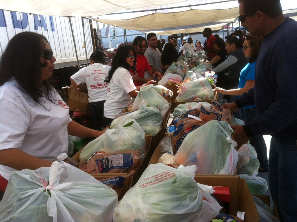 Dozens of volunteers give away about 1,500 food baskets to Southland low income families in this 2011 file photo. The International Longshore and Warehouse Union sponsored its 14th annual