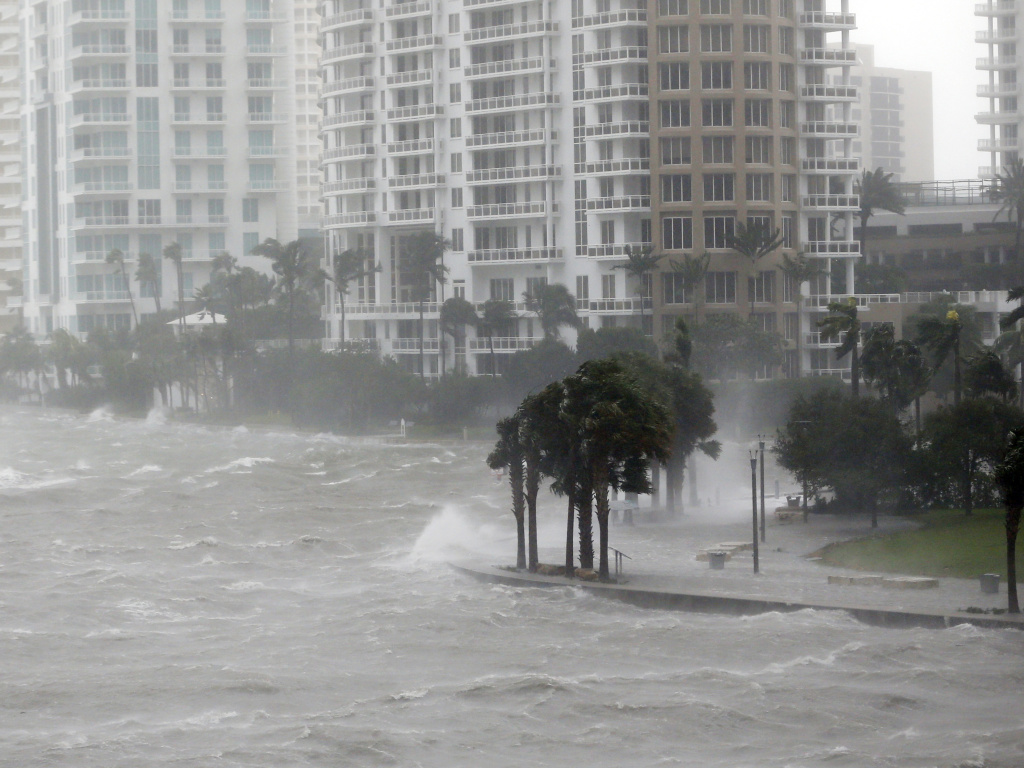 Hurricane Irma sends a storm surge crashing over a seawall at the mouth of the Miami River in Florida. The Army Corps of Engineers is proposing a network of more sea walls, gates and other barriers to protect the Miami waterfront from storms and hurricanes.