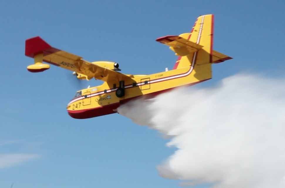 A Canadair Super Scooper releases water during a demonstration at the Van Nuys Airport in 2012.