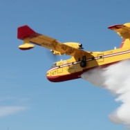 Canadair Super Scooper releasing its payload in a demonstration at the Van Nuys Airport 9-4-2012.