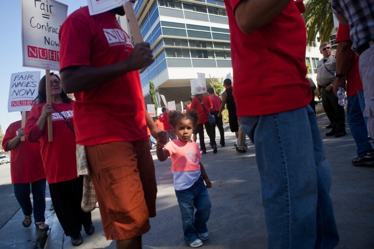 Roxana Medrano, a respiratory therapist at USC's Keck Medical Center, spins a noisemaker at a protest outside the facility on Wednesday.