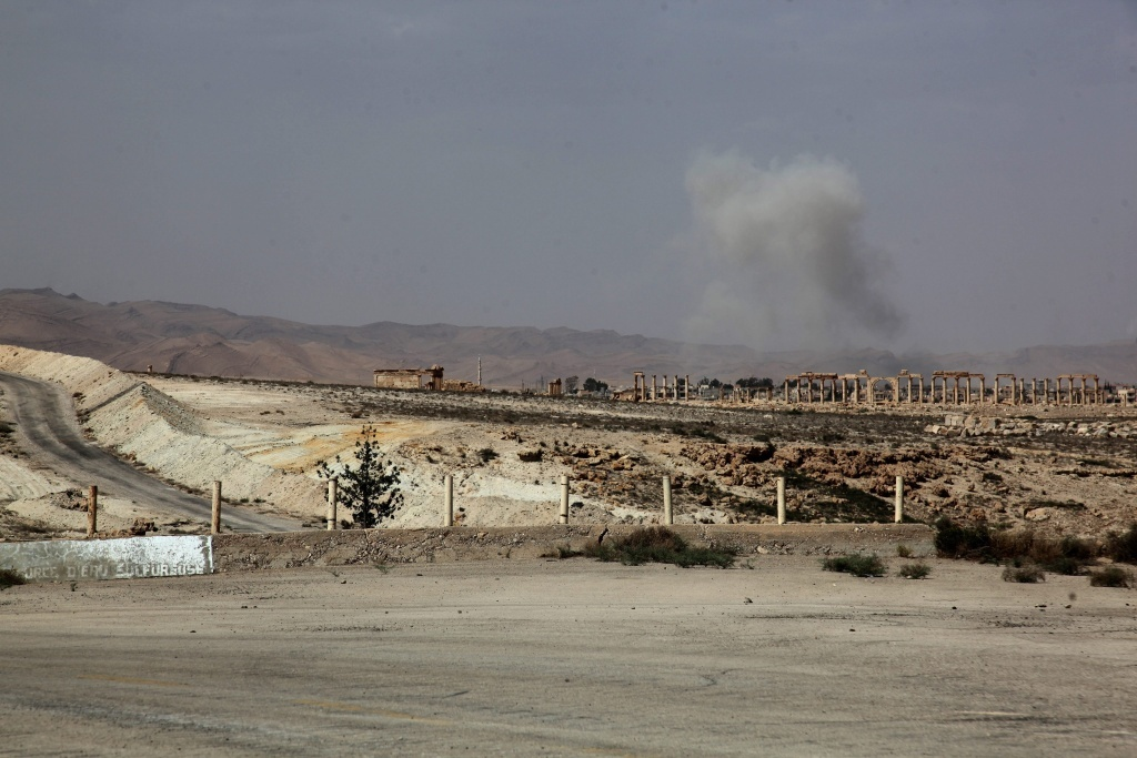 File: Smoke rises after a Syrian Rocket launcher shell on Islamic State positions in the ancient oasis city of Palmyra.