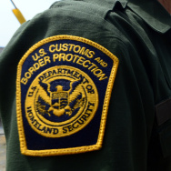 A US Border Patrol agent stands near a crossing to Mexico at the San Ysidro port of entry along the US-Mexico border near San Diego, California on April 4, 2013.
