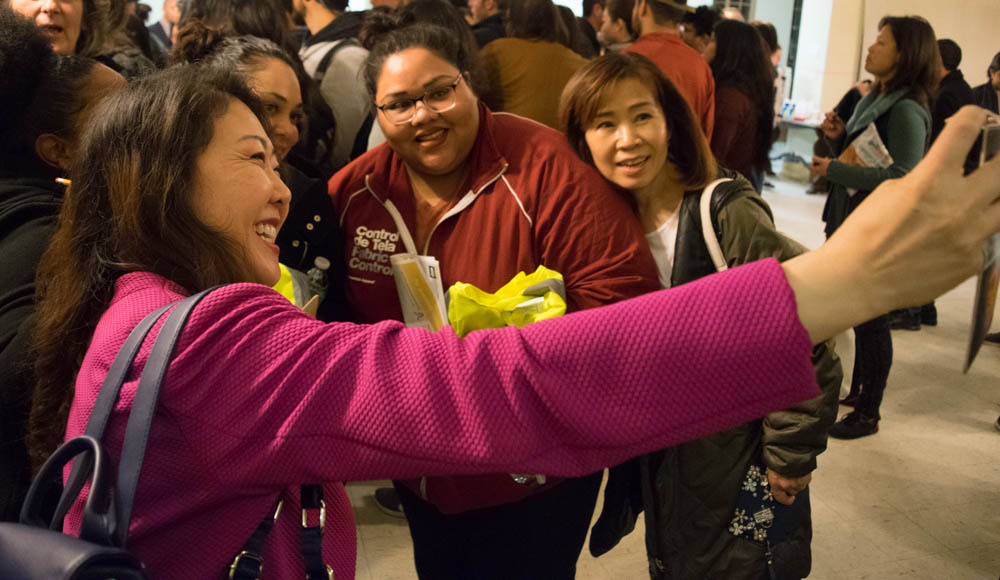 Hyepin Im snaps a selfie with several acquaintances before the 2018 Koreatown Homeless Count on Jan. 25, 2018. Im stops at several public events per week in her duties as a representative of the Korean Christian community with Faith and Community Empowerment (FACE).