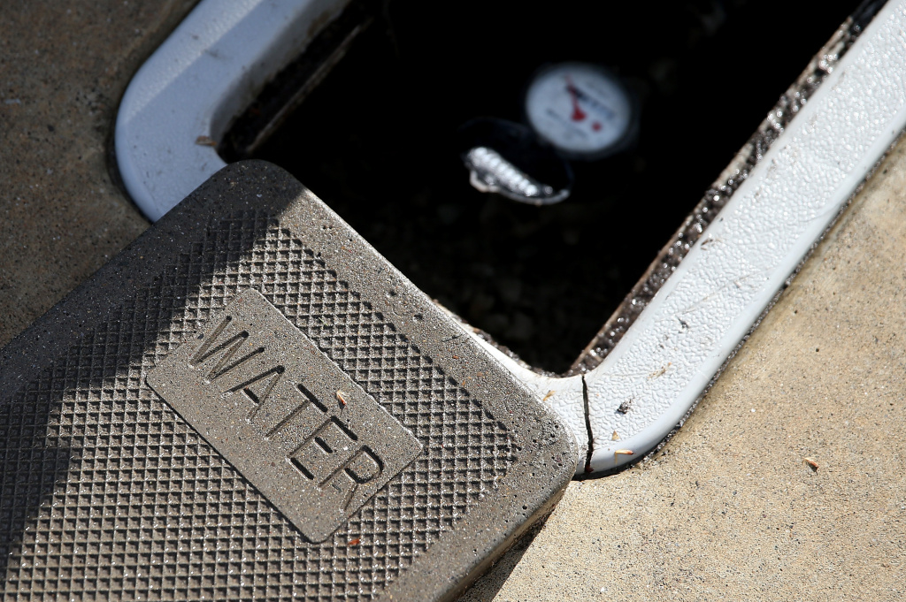 A cover sits next to a water meter on April 7, 2015 in Walnut Creek, California.