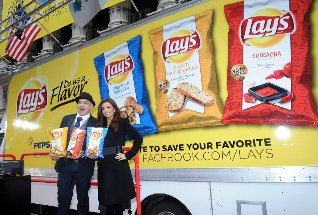 Actress Eva Longoria and Chef Michael Symon join the Lay's brand at the New York Stock Exchange, Tuesday, Feb. 12, 2013, in New York, to introduce the three Lay's
