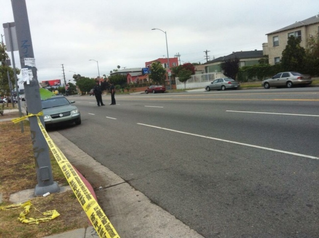 Police tape off an area where two undercover officers were shot Tuesday morning, June 25, 2013.