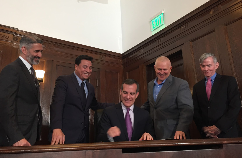 Mayor Garcetti signs an executive directive banning private talks between the planning commissioners he appoints and the developers whose projects are before them.