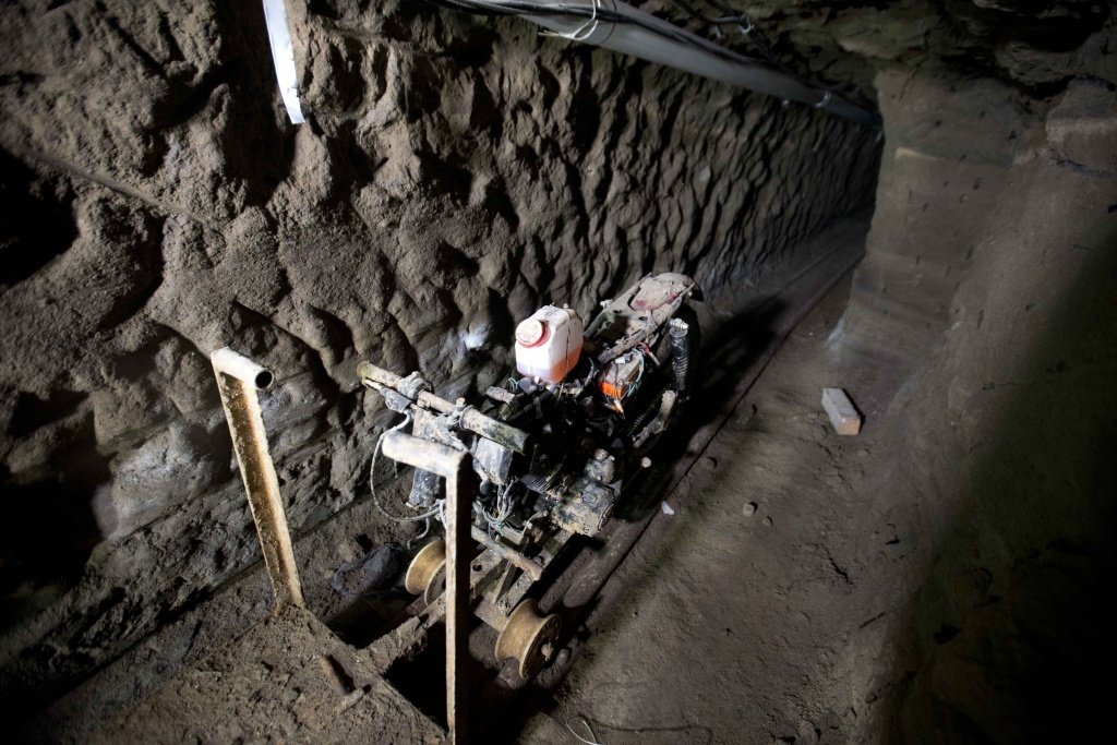 A motorcycle adapted to a rail sits in the tunnel under the half-built house where according to authorities, drug lord Joaquín