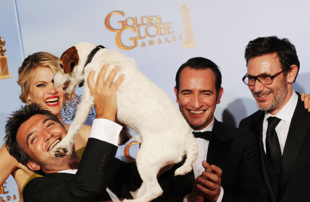 (L-R)  Producer Thomas Langmann, actress Missi Pyle, Uggie the Dog, actor Jean Dujardin, and director Michel Hazanaviciu pose in the press room with the Best Motion Picture - Musical or Comedy award for