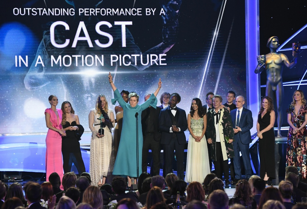 Frances McDormand gestures with the cast as 'Three Billboards Outside Ebbing, Missouri' after they received the award for Outstanding Performance by a Cast in a Motion Picture during the 24th Annual Screen Actors Guild Awards show at The Shrine Auditorium on January 21, 2018 in Los Angeles, California.