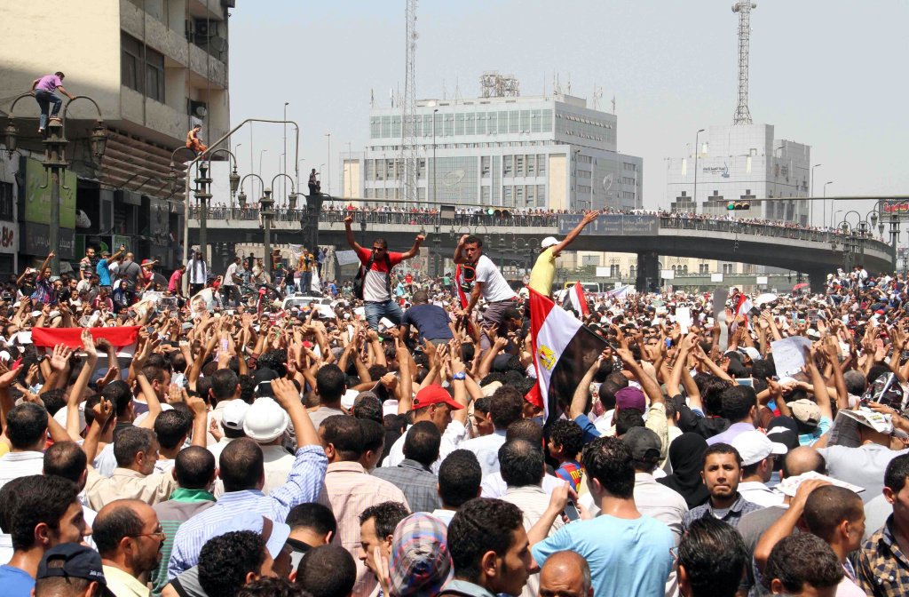 Egyptian Muslim Brotherhood supporters gather in Ramses square in Cairo on August 16, 2013 during a demonstration in support of Egypt's ousted president Mohamed Morsi.