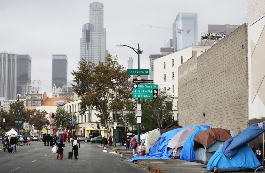 People walk through Skid Row in Los Angeles, California.